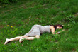 Woman's body lying in grass