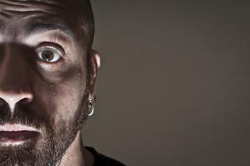 mid-frontal portrait of a man afraid