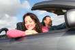 Couple riding convertible car