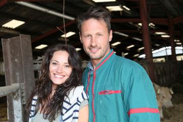 Couple of breeders standing in barn