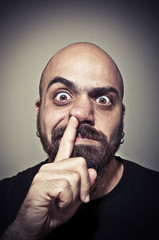 man with his finger in the nose
