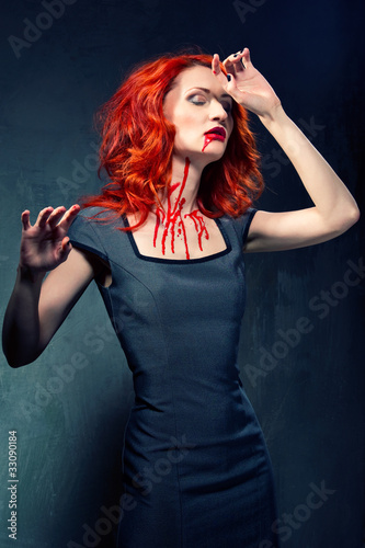 Portrait of a redhead woman with blood in her face and neck