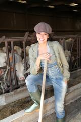 Portrait of smiling farmer in barn