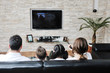 canvas print picture - family wathching flat tv at modern home indoor