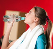 Woman at the gym drinking water