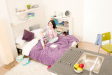 Student bedroom - young girl speaking on phone