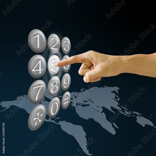 Finger pushing the button with world map background