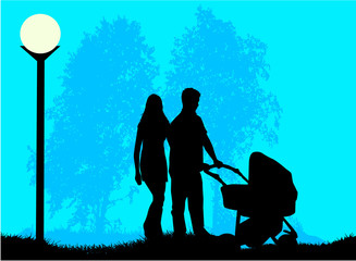 Parents with a child walking in the pram