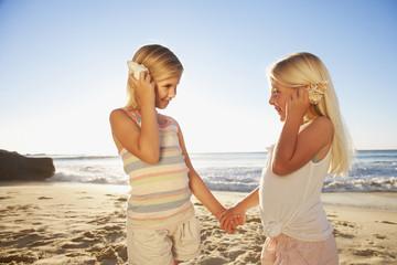 Girls with seashells on beach