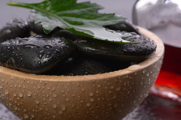 black hot stones in a bowl