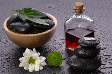 balanced stones and essential oil