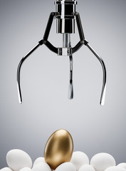 Mechanical claw reaching for golden egg