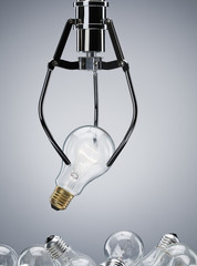 Mechanical claw lifting light bulb