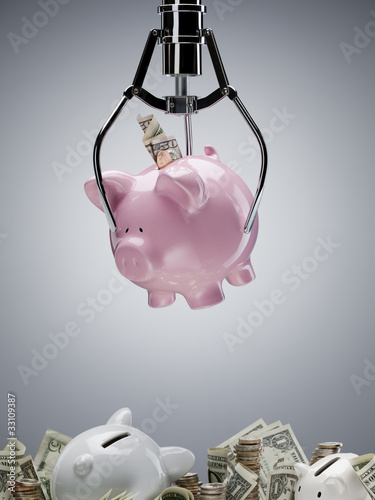 Mechanical claw lifting piggy bank
