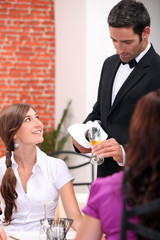 waiter serving wine
