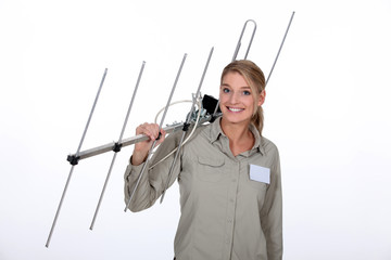 Woman carrying TV antenna