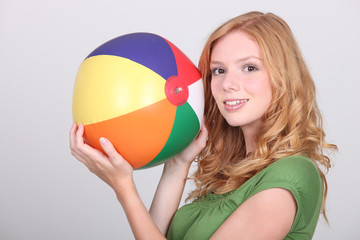 Girl holding inflatable beach ball