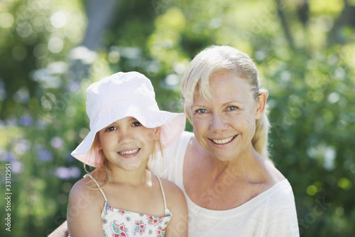 Grandmother and granddaughter outdoors