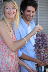 portrait of a couple with grapes