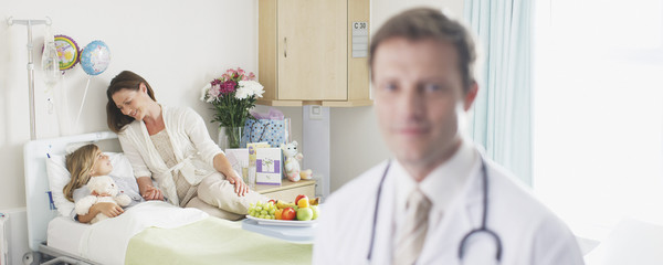 """""""Pediatrician, mother and patient in hospital"""""""