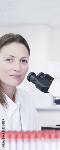 Close up of scientist with microscope