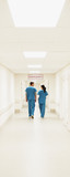 Nurses walking down hospital corridor