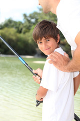 Father and son out fishing together