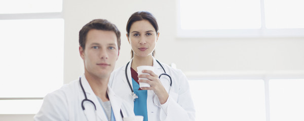 Portrait of doctors drinking coffee