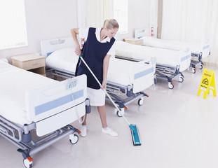 Orderly mopping hospital floor