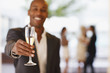 Close up of man holding champagne flute