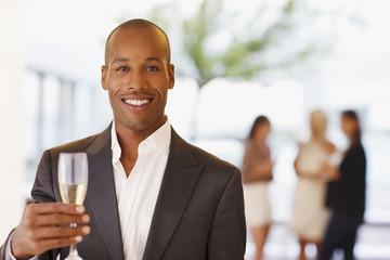 Portrait of man holding champagne flute