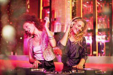 Female DJs in nightclub