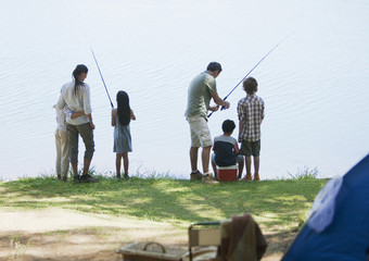 Family fishing near campsite