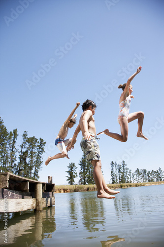 Kids jumping in lake