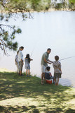 Family fishing lakeside