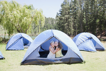 Girls hugging in tent