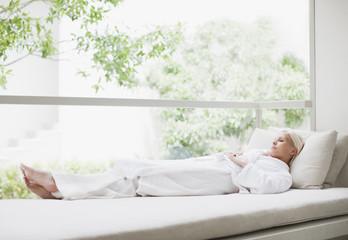 Woman laying in window