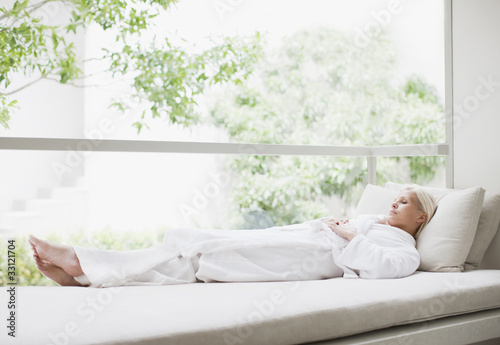 Woman laying in window