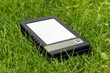 E-Book Reader in the grass