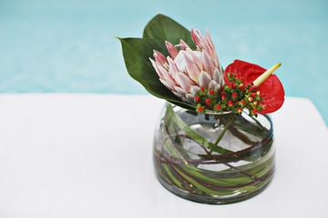 Flowers in vase at poolside
