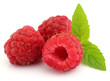 Fresh ripe raspberry with leaves of mint