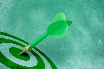 success conceptual. green dart hitting the target center.