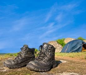 touristic boots near a touristic camp