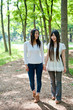 beautiful asian women walking in the forest