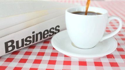 Close-up of coffee poured in a white cup on a table