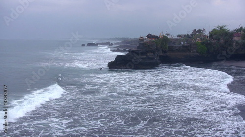 Ocean waves and old temple, Bali, Indonesia