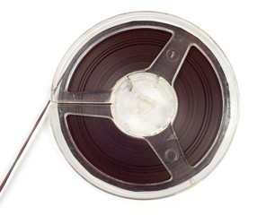 Plastic bobbin with magnetic tape isolated over white