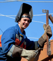 A welder working at height