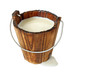 Leinwandbild Motiv milk in wooden bucket