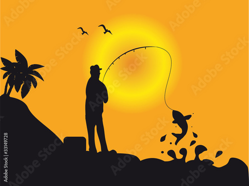 Fishermen in the sunset with fish - Angler